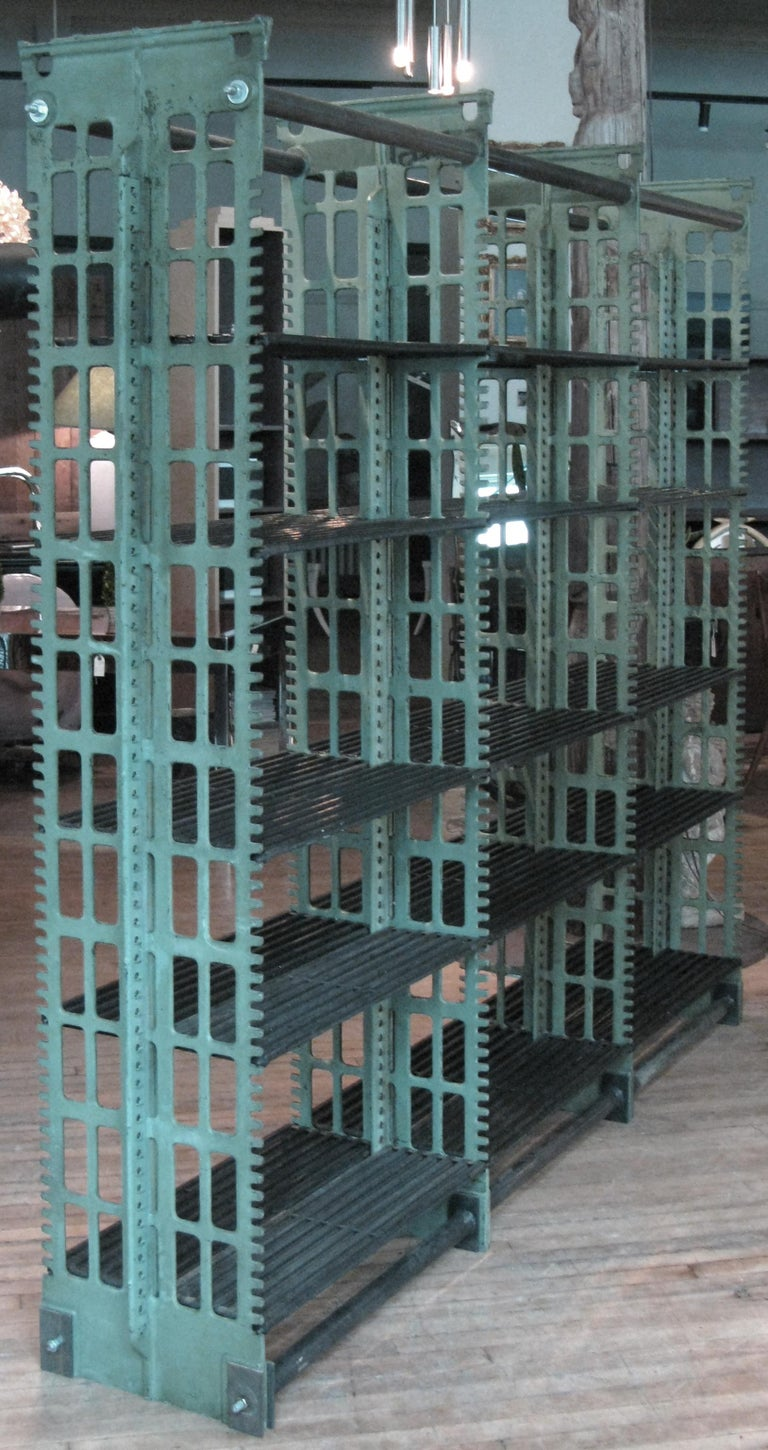 A rare pair of antique cast iron archival library bookcases designed by Angus McDonald and made by Snead. These impressive cast iron bookcases with adjustable steel shelves were the standard in the late 19th and early 20th century for library and
