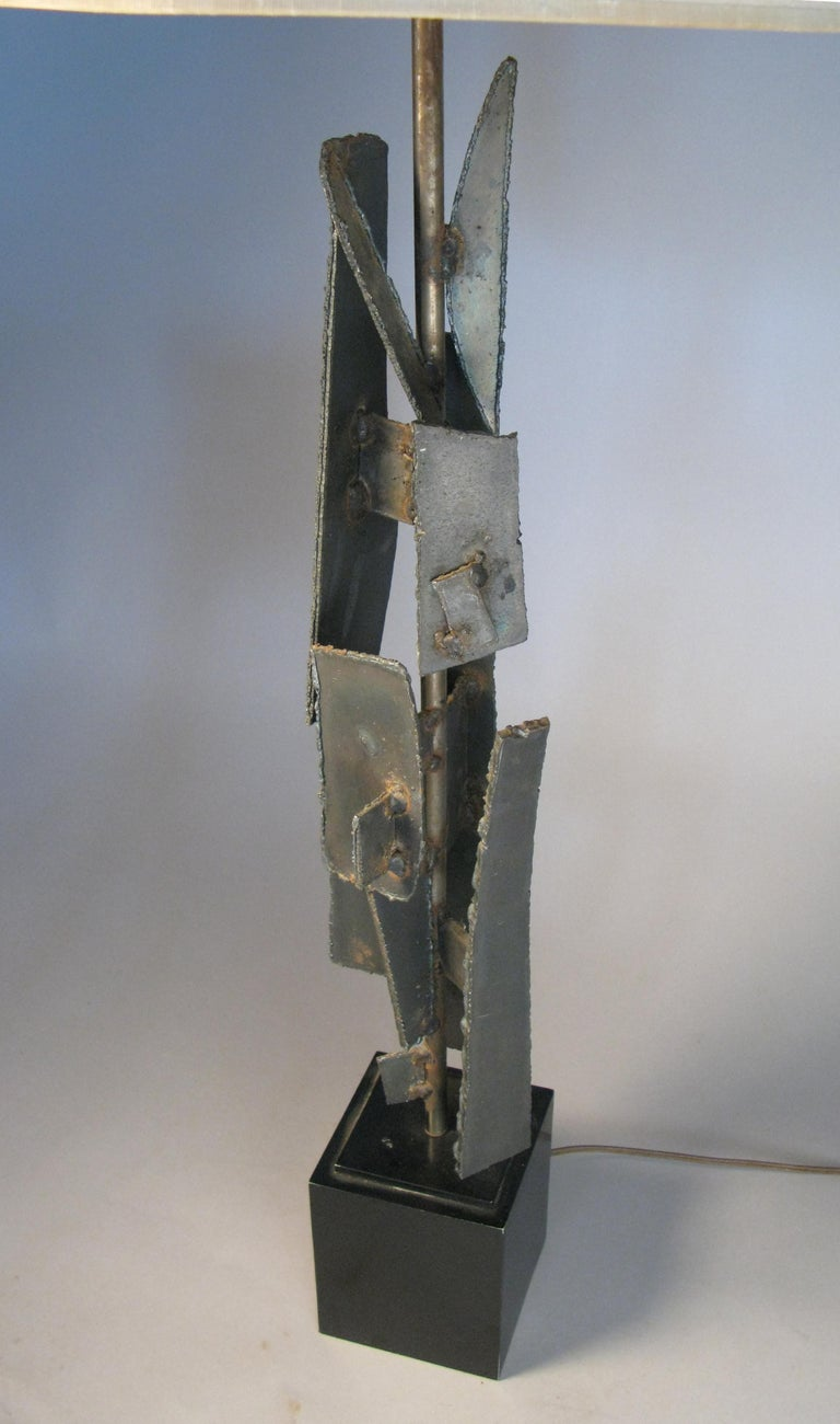 An iconic vintage 1960s iron and torch cut steel lamp by Harry Balmer, mounted on a square steel base. Shade not included.