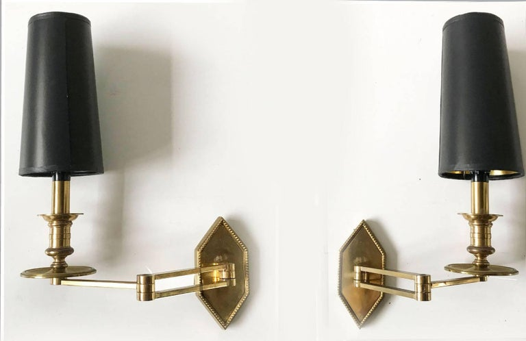 Pair of Maison Charles Swing Arm Sconces