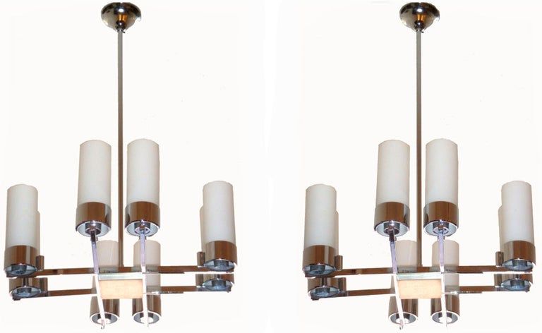 French chandelier by Jacques Adnet, 8 opalines tubes. Adjustable height. Pair available. US wired and in working condition.