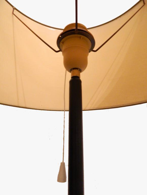Nice Jacques Adnet style floor lamp in black iron and brass, original shade.