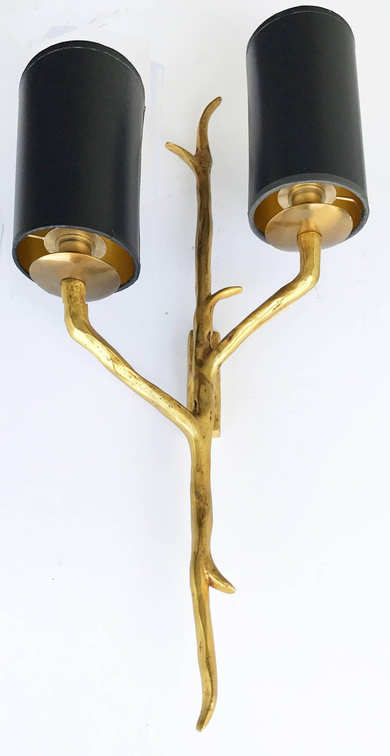 Superb pair of Agostini style bronze sconces Two lights, 85 watt max per bulb US rewired and in working condition Back plate dimension: 4 inches high, 1 3/8 wide Custom backplate available.