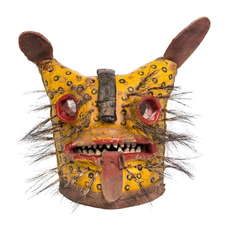 These masks depict jaguars and tigers used in ceremonies dedicated to a combative nature of feline/canine dances. Also used to enhance fertility and agriculture success.