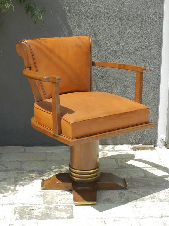 Exceptional and rare oak and brass swivel desk chair attributed to Jules Leleu, France, 1930.