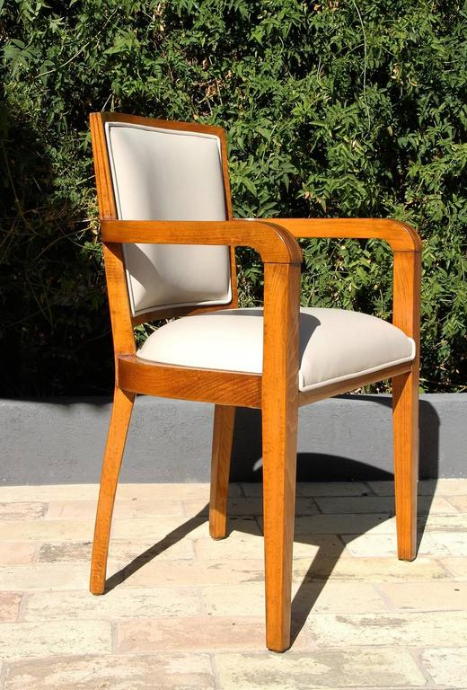 One beautiful pair of 1940s era Art Deco desk chair from French Governmental Institute.  This beechwood Art Deco pair of chairs has been beautifully refinished with a natural satin varnish and wax and reupholstered with a natural cream off-white