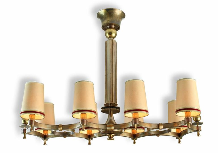Maxime Old (1910-1991).  Exceptional and probably one-of-a-kind bronze eight-light chandelier with eight arms diffusing lights through original lampshades.  Two tones of brass and patinated bronze lightly oxidized, make this chandelier a perfect