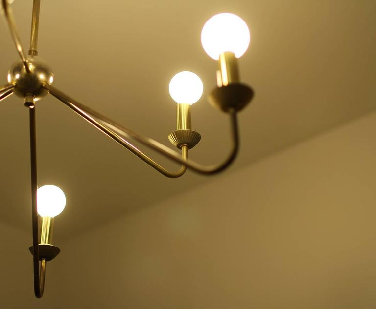 French Pair of Brass Chandeliers, Robert Caillat, circa 1955 For Sale
