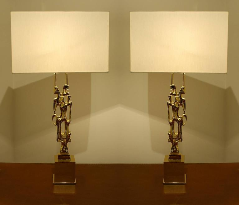 Pair of signed gilt bronze table lamps, signed Ph. Glapineau, active in the 1970s.