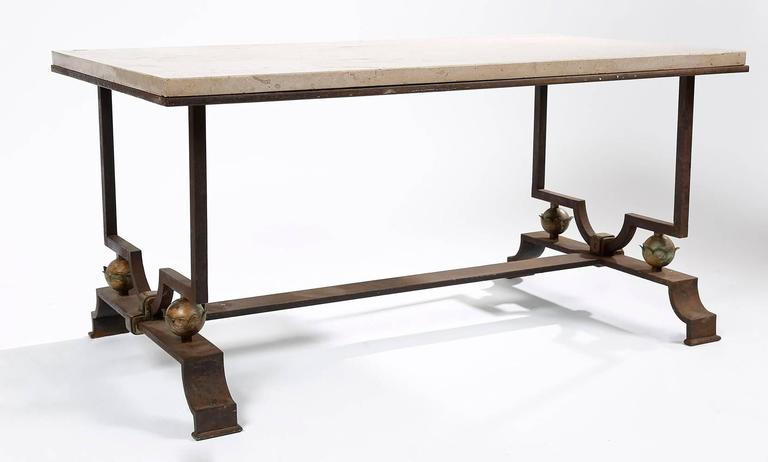 Jacques Quinet (1918-1992) & Gilbert Poillerat (1902-1988).  Exceptional wrought iron coffee table with a beige marble top, and four flower-like designs in gilt metal, located in each corner of the table.  This table is very interesting and very