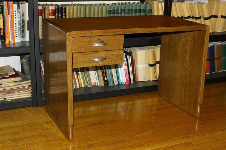 Jean Pascaud (1903-1996) Original oak desk from the Cite Universitaire of Paris with two drawers. Measurements: H 29