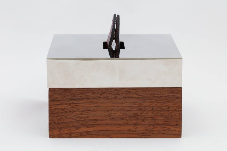 A classic handsome design  leather, wood and silver plated box byHermes.