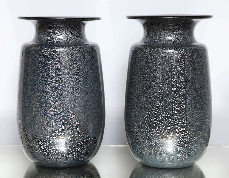 A beautiful pair of Murano glass vases attributed to Seguso Vetri d'Arte with cased silver leaf in clear glass over 'black/blue' glass.