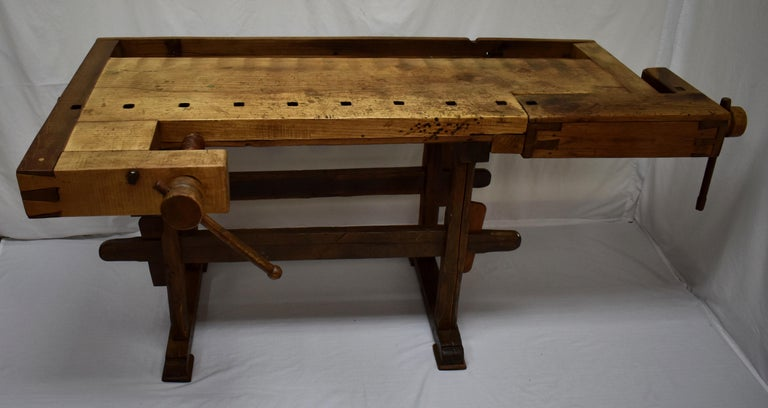 This outstanding oak Joiner's workbench is smaller than most. It is also less distressed than most, and while it bears all the scars of decades of purposeful use, it does not have the deep gouges, chops and multiple incisions found on most such