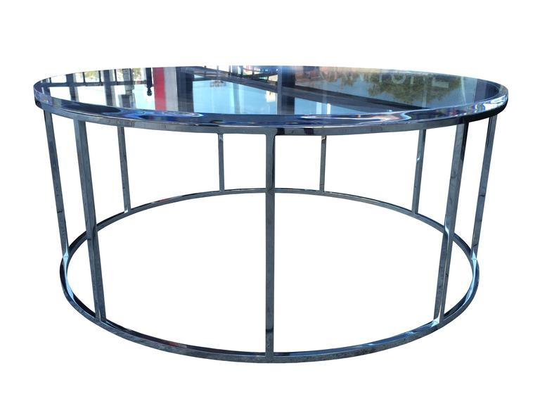 Minimalistic and whimsical style best describe this coffee table, executed in stainless steel with a high polished finish and topped with a 1