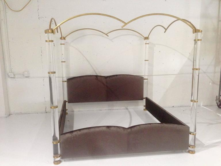 Stunning and beautiful is this king-size/poster bed designed and manufactured in Italy by Marcello Mioni in the early 1960s.  The bed is designed beautifully, the Lucite posts are thick and substantial, the solid brass fittings show a very nice