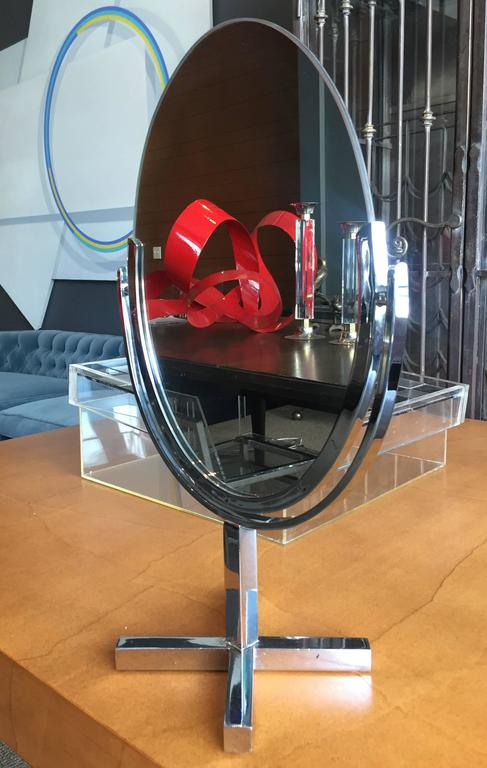 Stunning vintage table or vanity mirror in polished chrome by Charles Hollis Jones in the late 1960s. This mirror is double-sided and it is perfect to be used at a makeup store or dressing room. The piece is in very good original condition and the