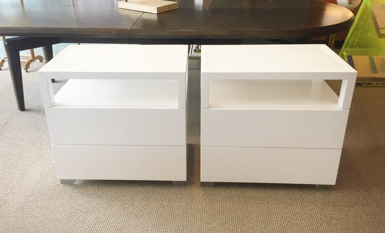 Beautiful pair of nightstands made of solid white oak and Lucite with a milk glass tops.