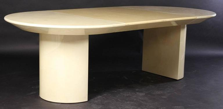 Double pedestal base, beveled underside, the table comes with two leaves that are 20