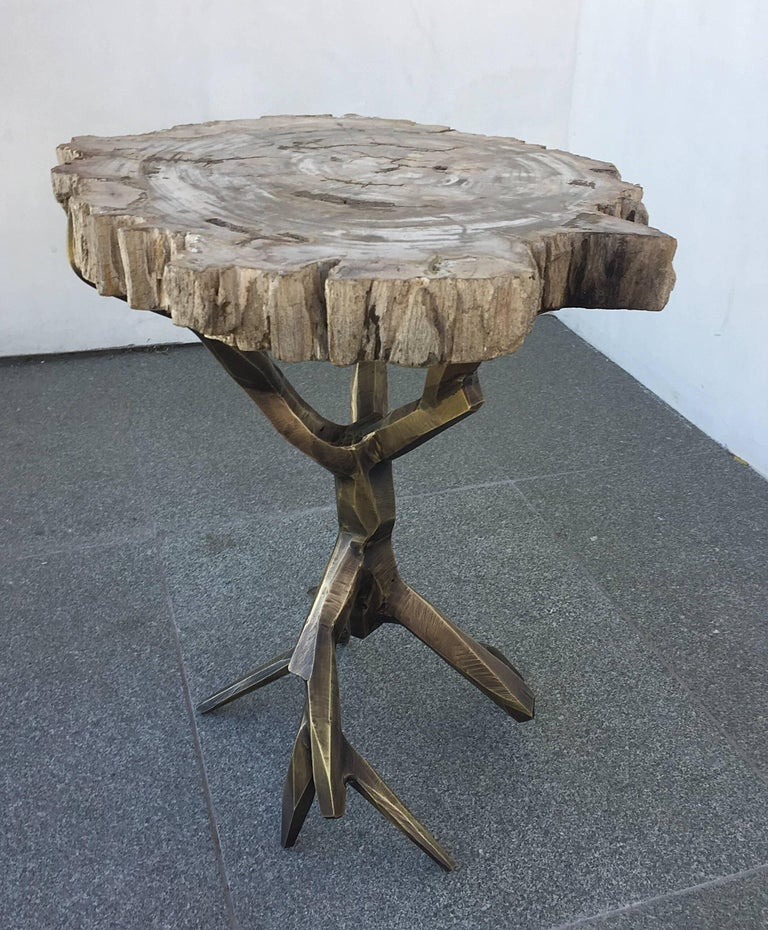 Beautiful side table made out of solid brass with a bronze finish is a one of a kind creation by designer Amparo Calderon Tapia designed exclusively for Cain modern.