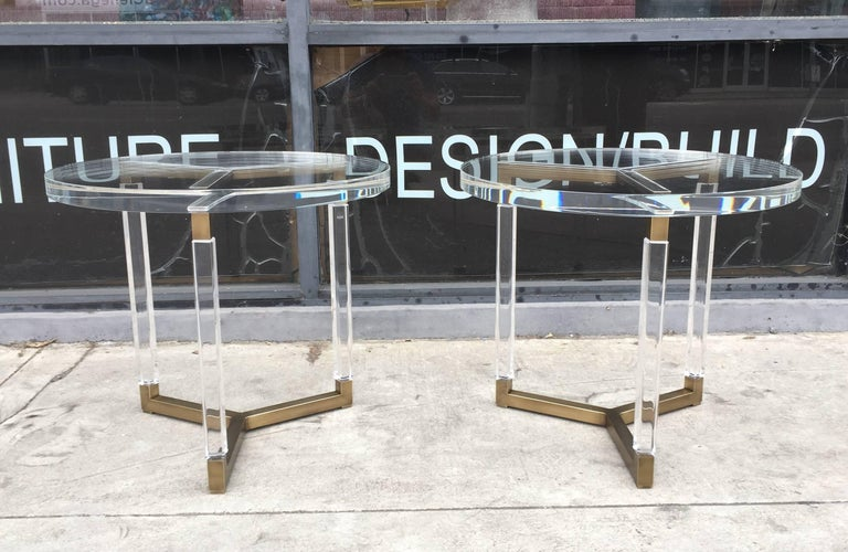 Beautiful set of side tables in solid brass and Lucite designed and manufactured in the 1960s by Charles Hollis Jones as part of his Metric collection.  The tables are in very good condition, the Lucite is free of chips, crazing or clouding and