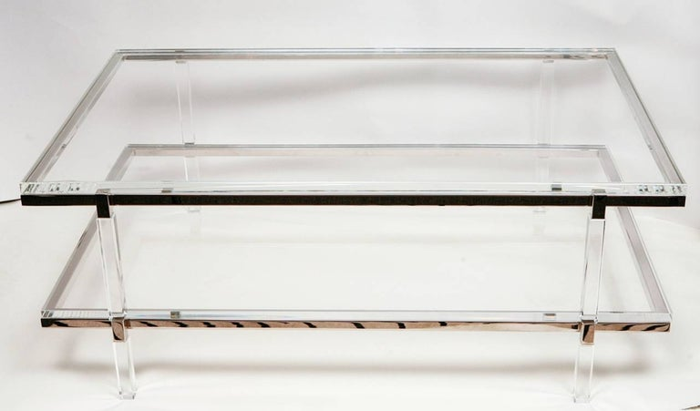Two-level coffee or cocktail table designed and manufactured by the Icon of Lucite Charles Hollis Jones as part of the Metric collection designed in the 1960s.  The table is executed in Lucite and nickel topped with a 1