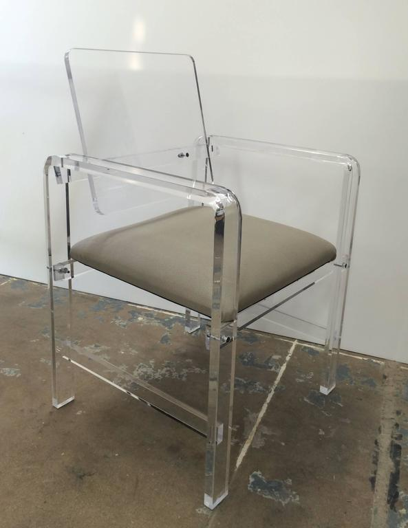 Beautiful and modern Lucite armchairs made to order and upholstered in COM or COL at no additional charge. These chairs are newly manufactured by Cain Modern and the can be customized and made in clear or smoked Lucite.  The chairs are very well