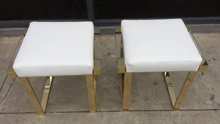 Amazing pair of Lucite and brass benches designed and manufactured by Charles Hollis Jones as part of his