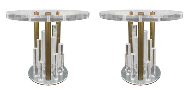 Beautiful set of side tables in Lucite and brass designed and manufactured by Charles Hollis Jones in the early 1970s. These