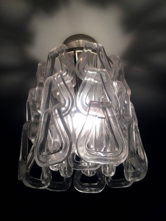 Stunning Murano glass chandelier designed and manufactured by Mazzega. The chain like pendants drape over the chrome frame, the glass is heavy and thick but is very delicate to the eye.  These chandelier came out of a NY estate, they where
