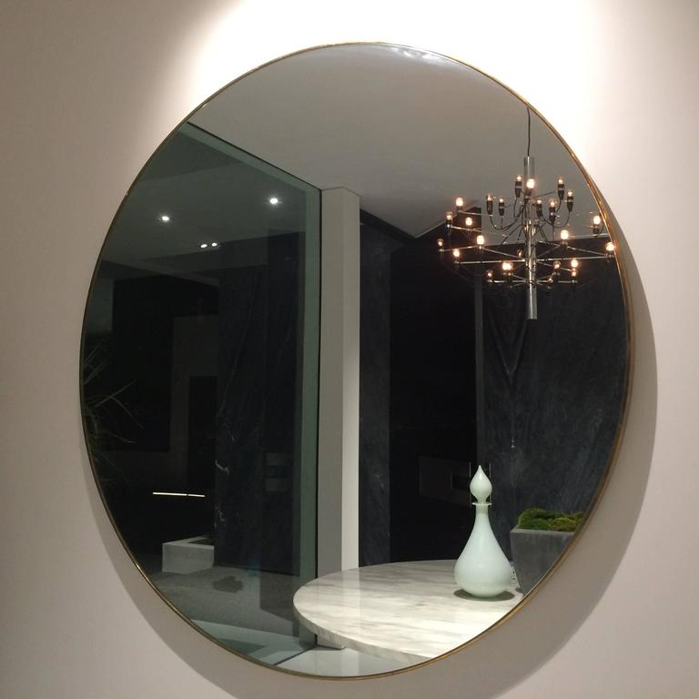 Stunning 5ft round brass mirror designed by Cain Limited and made here in Los Angeles by a master sculptor. This is part of the