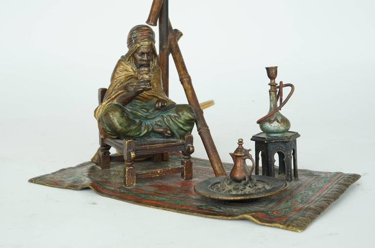 Bronze Bergman Lamp of a Seated Man on Chair Having Coffee In Excellent Condition For Sale In New York, NY