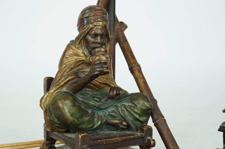 19th Century Bronze Bergman Lamp of a Seated Man on Chair Having Coffee For Sale