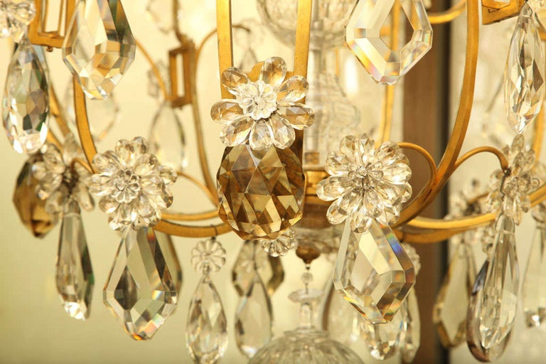 French Large Twelve Light Crystal and Bronze Chandelier Attributed to Bagues For Sale