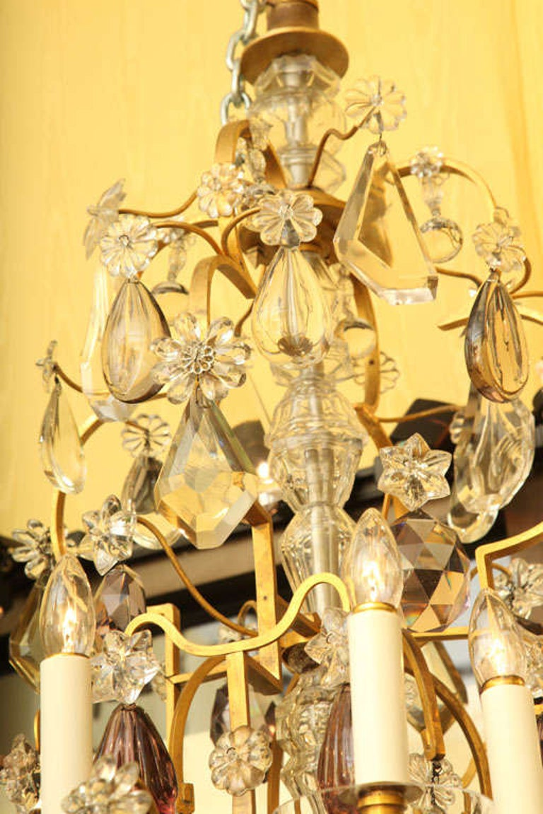 Gilt Large Twelve Light Crystal and Bronze Chandelier Attributed to Bagues For Sale