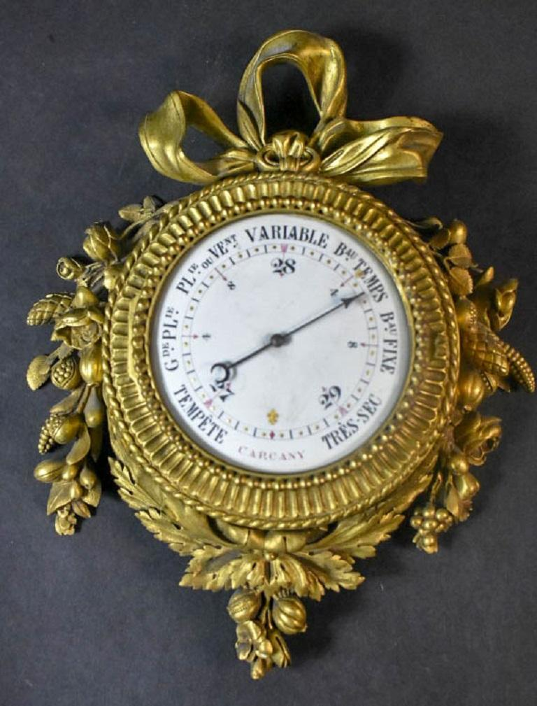Pair of 19 century French Louis XVI style gilt bronze wall clock and barometer signed: Passements Frer du Roy.