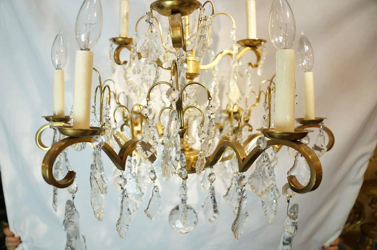 Nine-Arm Crystal and Gilt Brass Louis XV Style Chandeliers In Good Condition For Sale In New York, NY