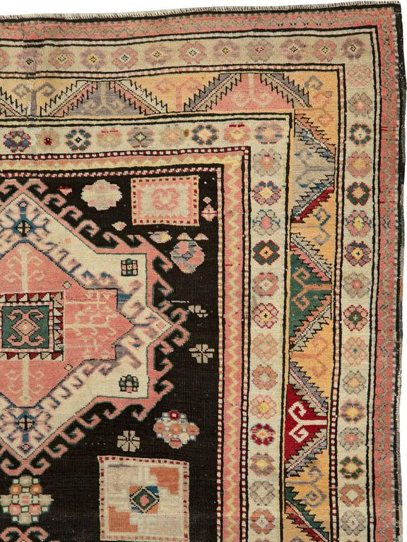 An antique Russian Karabagh carpet from the second quarter of the 20th century.