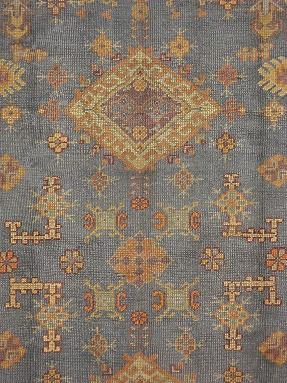 A vintage Turkish Oushak carpet from the second quarter of the 20th century.  Measures: 7' 3
