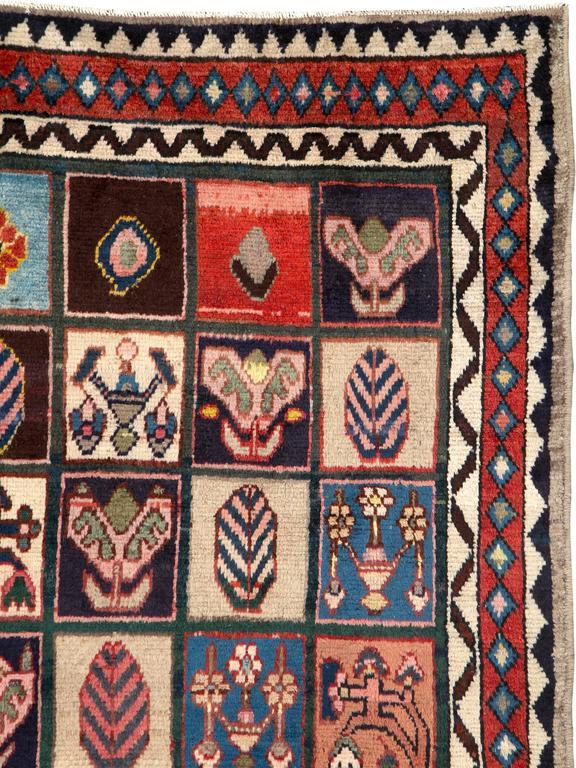 A garden design Persian Bakhtiari rug from the mid-20th century.  Measures: 5' 7