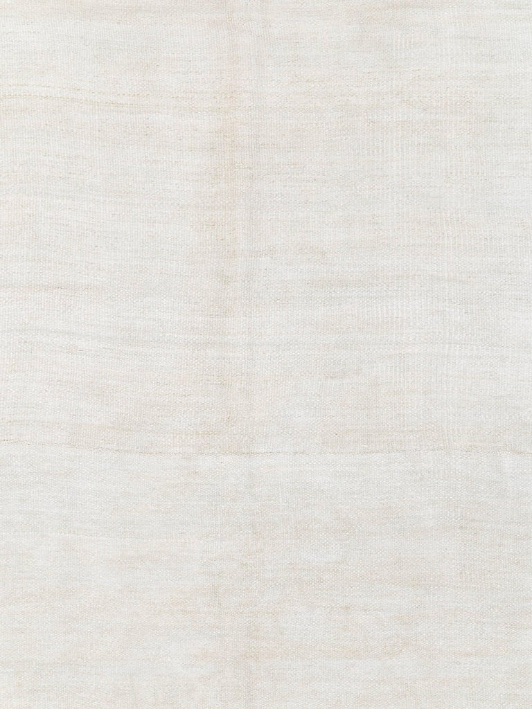 A white vintage Turkish flat-woven carpet from the mid-20th century.