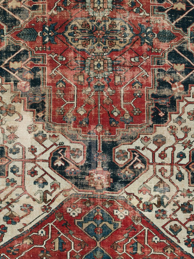 An antique Persian Bakhtiari rug from the early 20th century with a naturally distressed appeal.