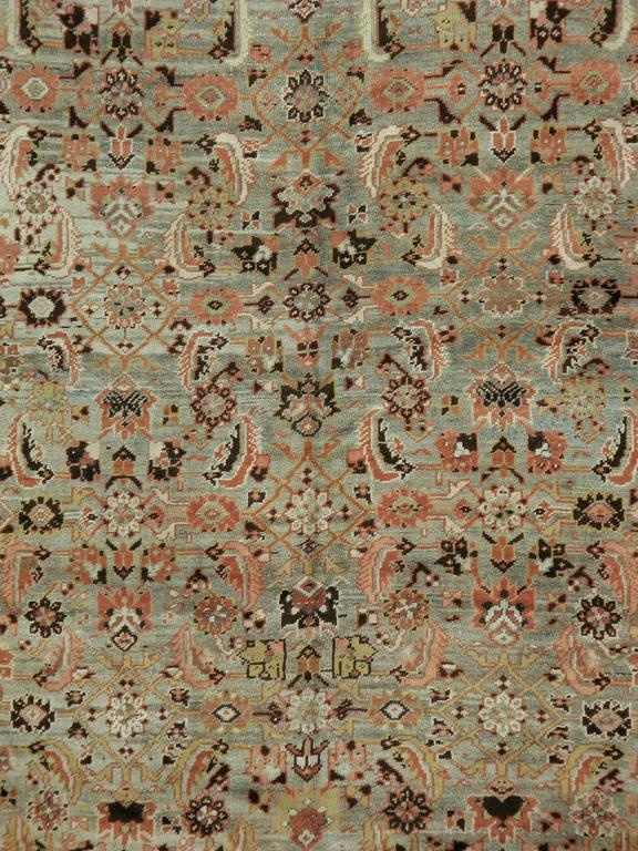 An antique washed Russian Karabagh carpet from the first quarter of the 20th century.