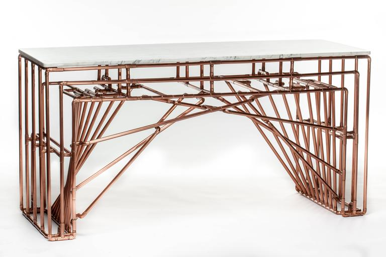 Title: Brooklyn-Barcelona Table Year: 2013  The Brooklyn-Barcelona console table is a graceful merger of styles and continents. The under-arch is designed to evoke the iconic cabling of the Brooklyn Bridge and the negative space it creates is in