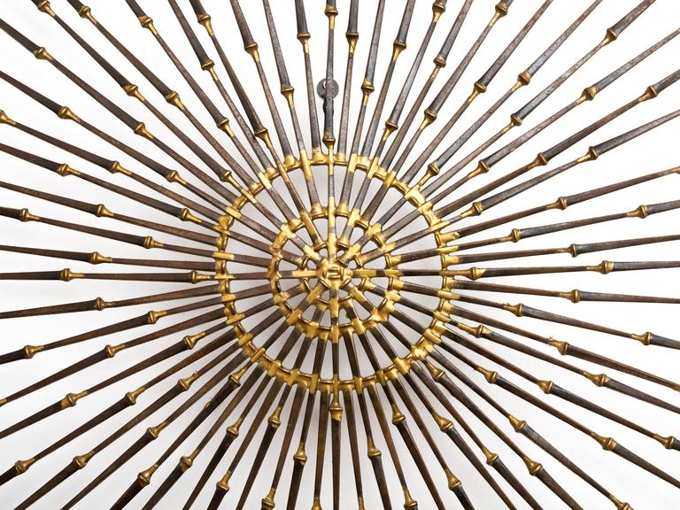 American Gilded Metal Sunburst Wall Sculpture Art by Ron Schmidt, circa 1969 For Sale