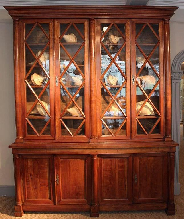 A fine early 19th century large French bookcase (or deux corps bibliotheque), of cherry wood, retaining the original glass panels. Wonderful color and patina. 