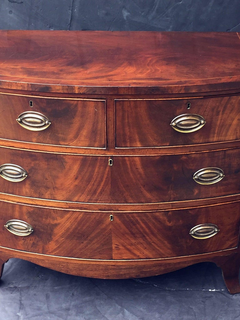 English Bow Front Chest of Inlaid Flame-Cut Mahogany 4