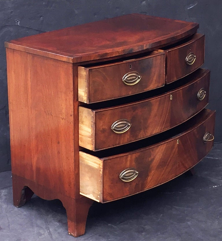 English Bow Front Chest of Inlaid Flame-Cut Mahogany 7