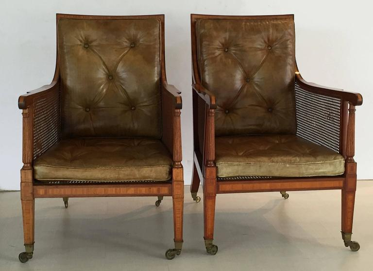 A Handsome Pair Of Fine English Caned Library Bergere Armchairs From The Edwardian  Era, Each