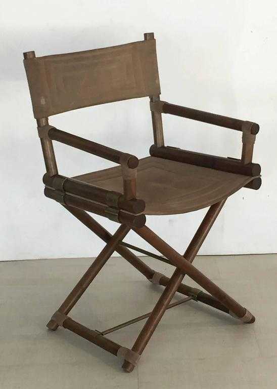A pair of handsome Italian director's chairs featuring fine polished wood and warm brass frames with suede leather backs and seats.  Dimensions:  H 34 1/2