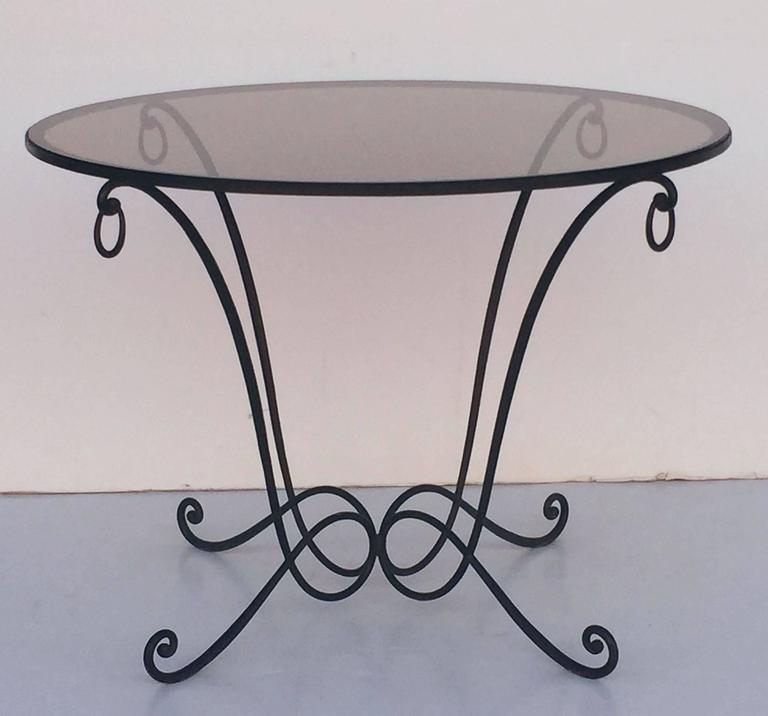 A Fine French Round Table Of Wrought Iron With A Smoked Glass Circular Top,  Featuring